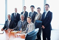Portrait of smiling business people in conference room