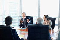 Business people meeting at table in conference room (thumbnail)
