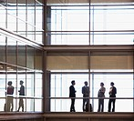 Business people talking in modern office corridor (thumbnail)