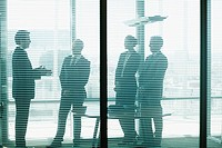 Silhouette of business people talking in conference room