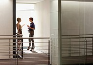 Businesswomen talking in window of modern office