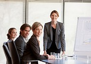 Portrait of smiling business people meeting in conference room (thumbnail)