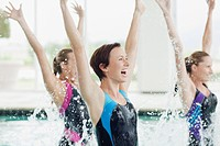 Enthusiastic women jumping in swimming pool (thumbnail)