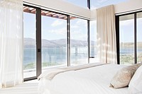 Modern bedroom with view of lake