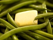 Close up of butter on green beans
