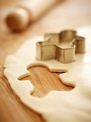 Gingerbread man cookie cutter on dough