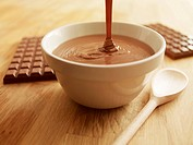 Melted chocolate pouring into bowl
