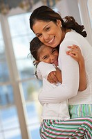 Hispanic woman hugging her daughter