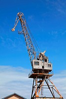 Retired Steel Construction Crane in a Shipyard