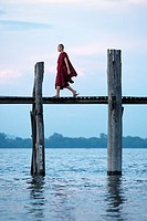 Buddhist monk walking over U Bein's bridge  Amarapura, Myanmar