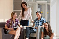 Teenage girls studying in the college lounge