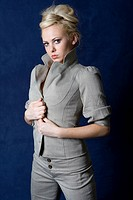 blond girl posing in a business suit