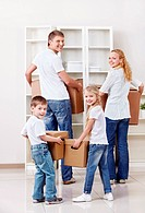 Family with cardboard boxes indoors