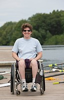 Woman with spinal cord injury sitting in a wheelchair on the dock