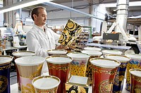 Final inspection of a Versace vase after polishing the gold at the porcelain manufacturer Rosenthal GmbH, Speichersdorf, Bavaria, Germany, Europe