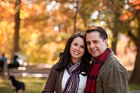 Couple smiling in a park