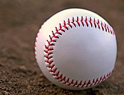 Closeup of a Baseball Sitting in Infield Dirt