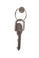One grey key on a white background