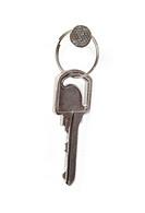 One grey key on a white background
