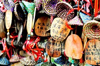 close_up of colorful wooden buddhist prayer tablets in lijiang, China also seen on the show ´Amazing Race´
