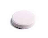 single white tablet on white background. Shallow DOF