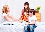 Mother happy to receive greeting card from kids