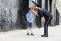 Woman police officer talking to a boy