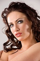 beauty portrait of graceful brunette woman with creativity hairstyle and makeup