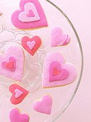 Pink heart_shaped biscuits on a glass plate