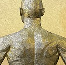 Back or rear upper body view of a golden metallic, faceted, engraved, textured and reflective human male body figure including back, shoulders, neck, ...