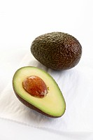 Avocados, whole and halved