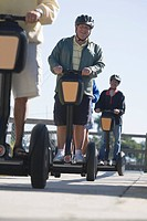 Tourists riding segways