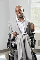 Businessman with Cerebral Palsy sitting in a wheelchair and smiling
