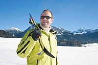 Man with cross_country skis in the mountains