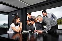 Businessteam playing chess