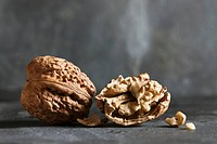 Whole walnuts and half a walnut