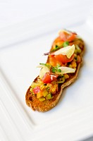 Crostini topped with vegetables