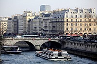 Tour boat in River Seine with the view of Saint-Michel Metro station area of Lift Bank in the background  Paris  France.