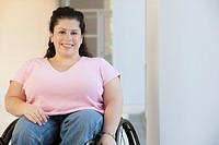 Disabled woman sitting in a wheelchair and smiling