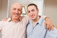 Portrait of father smiling with his son smiling