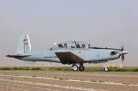 An Iraqi Air Force T_6 Texan trainer aircraft taxis out for a flight over Tikrit, Iraq.