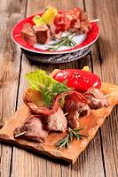 Shish kebab and rasher of crispy bacon