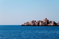 A lone lighthouse on a small island
