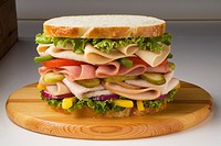 Large Chicken, Ham and Turkey Sandwich with Veggies on White Bread