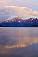 Grand Teton Mountains at sunrise with lake in front