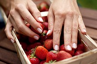 Hand at strawberries