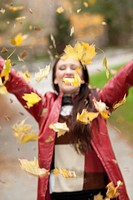Women throwing leaves in autumn, Toronto, Ontario, Canada