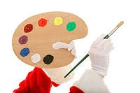 Santas hands isolated with paintbrush and artist palette. Focus on hand with the brush.