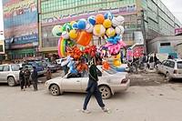 street vendor selling plastic toys