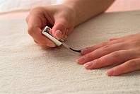 Young female is making french manicure herself.